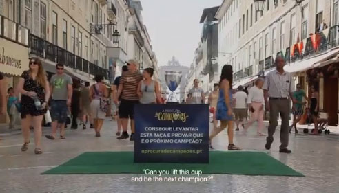 Ford Ad Campaign Challenges Passers-By To Lift A Trophy Like A Soccer Champion