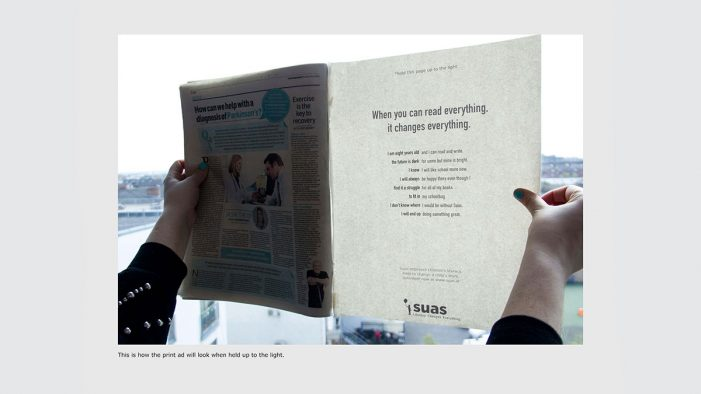 Invisible Newspaper Print Revealed by Light Shows How Literacy Can Change Everything
